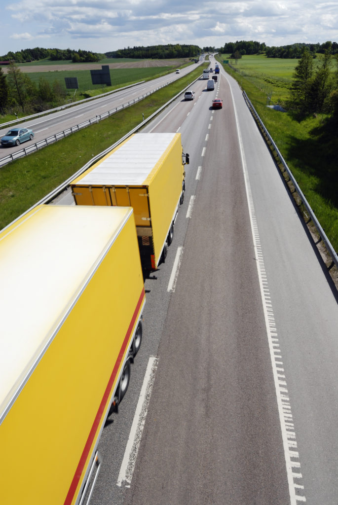 truck driving on a straight freeway elevated view SFCx UCEs